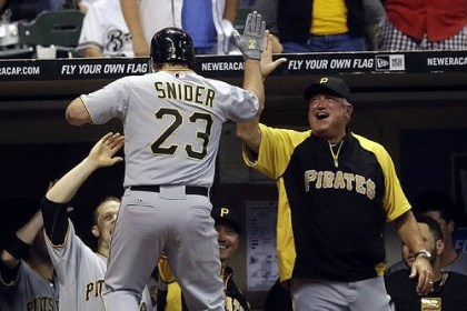 Travis Snider 2 Pirates manager Clint Hurdle greets Travis Snider after Snider's ninth-inning home run put the Pirates ahead, 4-3, in the win against the Milwaukee Brewers.