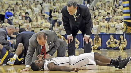 Tray Woodall INJURED Pitt's Tray Woodall is attended to by trainer Tony Salesi and head coach Jamie Dixon after colliding with Marquette's Derrick Wilson in the first half this afternoon at the Petersen Events Center. Woodall left the game with a concussion.