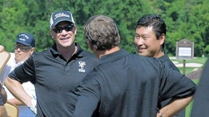 Troy Loney and Jim Paek, Former Penguins Troy Loney, left, and Jim Paek, center, talk with other players Tuesday as members of the 1991 Stanley Cup championship team had a 20th reunion at Valley Brook Country Club in McMurray.
