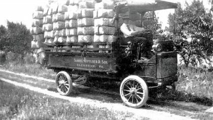 Truck driving Stephen Affolder, at the wheel of the family farm truck, heads to market on the North Side in the early 20th century.