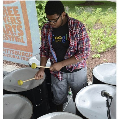 Tylik Griffin, 16, Tylik Griffin, 16, performs with the Soundwaves Steel Drum Band last week at the Three Rivers Art Festival.