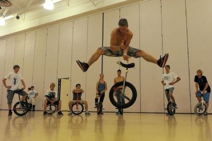"Unicycle 1 Eli Brill of Pine Grove, near Harrisburg, does a trick Tuesday as a group of unicyclists play a game called ""Back It Up"" during the 2013 Unicycle National Convention at Seneca Valley High School."