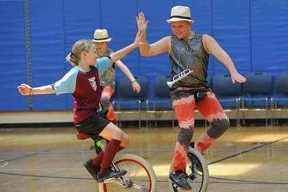 Unicyclists 2 Sylvie Panofsky, 9, high-fives Hayden Cohan, 12, both of Madison, Wis., before they compete against each other in the youth intermediate freestyle pairs competition.