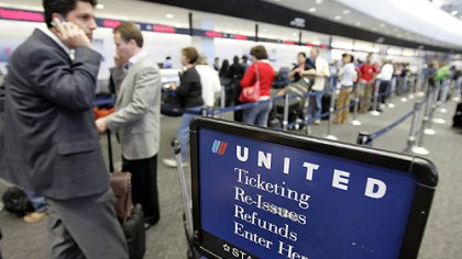United Airlines passengers check in United Airlines passengers check in at San Francisco International Airport.