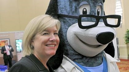 United Healthcare of Pennsylvania and Delaware Sue Schick, CEO of United Healthcare of Pennsylvania and Delaware, stands with Dr. Health E. Hound during the UHC health fair at the Wyndham Grand hotel on Tuesday.