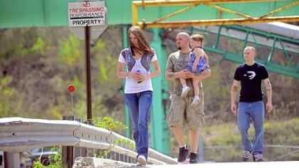 Upper Big Branch Mine On April 7, two days after the fatal explosion, miner Brent Racer, center, walks with his daughter Alayah, 2, his wife Tara and miner Patrick Lomas after they picked up their paychecks from the Upper Big Branch Mine.