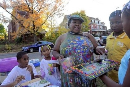 Vanessa German and Sunny LIttlejohn Sunny Littlejohn, 10, right, presents Vanessa German with a painting she made at the Art House.
