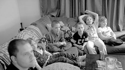 Video games Bob plays a video game with Robert Jr., (third from left), while Raine, Ashton, Laurel and Autumn watch.