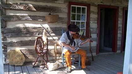 Violin player During a Colonial fair in 2006, re-enactor William Donaldson plays the violin on the front porch of Negley House, a log home once occupied by German settlers. Negley House is located on the 20-acre property of the Conoco-cheague Institute.