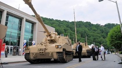 Visitors look over the display of vehicles Visitors look over the display of vehicles by BAE Systems at the Showcase for Commerce at the Cambria County War Arena in Johnstown. Among them is this Paladin Integrated Management vehicle.