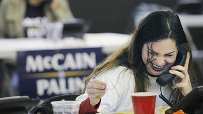 Volunteer Lucy Malkani, of Ben Avon, makes calls on behalf of the McCain/Palin campaign at McCain headquarters in Greentree, yesterday.