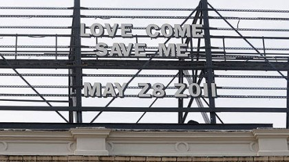"Waffle Shop billboard love message A message on the billboard above the Waffle Shop read ""LOVE COME SAVE ME, MAY 28 2011"" on a recent day this month."