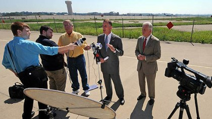 wagner and murphy 911 U.S. Rep. Tim Murphy (center) and Pa. Auditor General Jack Wagner (right) answer reporters' questions after a tour of the 911th Airlift Wing Air Force Reserve Base at the Pittsburgh International Airport today.