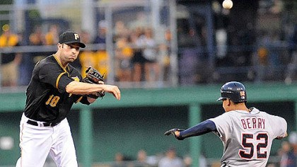 Walker fires off a double play The Pirates' Neil Walker checks off Detroit's Quintin Berry in the top half of a double play last night at PNC Park.