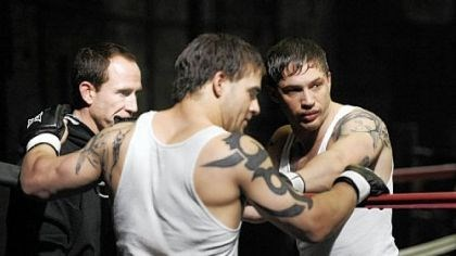 """Warrior"" 2 Eric Hibler, left, owner of Eric Hibler's Pittsburgh Fight Club, talks with stunt double Jace Jeanes, center, and actor Tom Hardy before a take on the set of ""Warrior."""