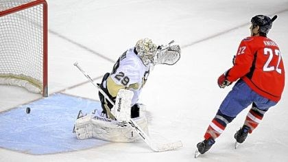 Washington 4, Penguins 3 Through this pileup in the Penguins' net, Washington's Mike Knuble scores a goal against Marc-Andre Fleury in the second period Wednesday night in Washington. Jordan Staal tries to stop Knuble, who would later win the game in a shootout.