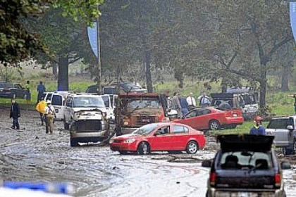 Washington Boulevard flooding Aug. 19, 2011: Cars strewn on Washington Boulevard after storms brought heavy rains and street flooding. Four people died.