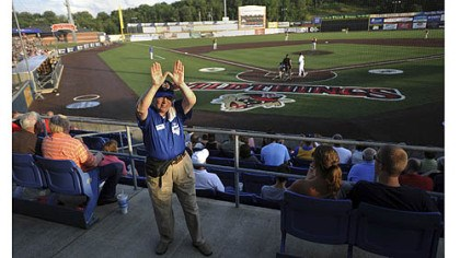 "Washington Wild Things usher ""The Pirates have a 'Z,' but we have a 'W,' "" says usher Pat Swihart, who tries to rouse the crowd Saturday at a Washington Wild Things home game against the Traverse City Beach Bums at Consol Energy Park."