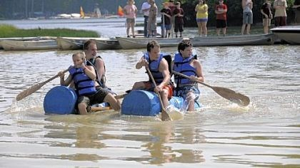 "Water ways Paddling in an ""Anything That Floats"" contest on Lake Courage are, in craft at left, Dakota Korinko, 11, front, and Aaron Funaiock, 14. In craft at right are Matt Gwynn, 13, front, and Tony Donatelli, 14. All belong to South Park Troop 510."