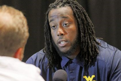 West Virginia-2 West Virginia defensive lineman Will Clarke talks to members of the media at a breakout session Tuesday for the Big 12 Conference football Media Days in Dallas.