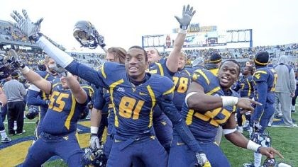 West Virginia players celebrate West Virginia's Tyler Rader, J.D. Wood and Ryan Clarke celebrate after beating Rutgers, 35-14, Saturday in Morgantown, W.Va.