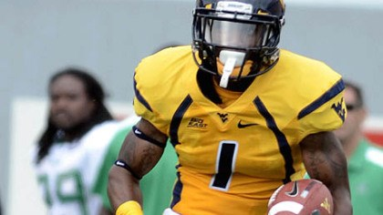 West Virginia's Tavon Austin West Virginia's Tavon Austin carries the ball Sunday against Marshall. The Mountaineers rushed for 42 yards before the game was called early in the fourth quarter.