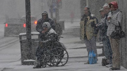 wheelchair people at bus stop pittsburgh A group of people wait to cross Stanwix Street in Downtown Pittsburgh this morning as heavy snowfall continues.