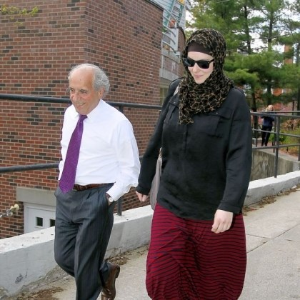 Widow Katherine Russell, widow of Boston Marathon bomber suspect Tamerlan Tsarnaev, leaves the law office of DeLuca and Weizenbaum with Amato DeLuca on April 29 in Providence, R.I.
