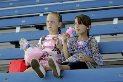 Wild Things 2 Twins Katie and Karlie Leadingham, 6, of Canonsburg eat cotton candy as they wait for the start of the Wild Things game against the Beach Bums last year.