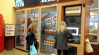 Wine kiosk Mallory Mullady, left and friend Laura Burnes, students at the University of Pittsburgh, buy wine from the kiosk at the Giant Eagle Market District in Shadyside.