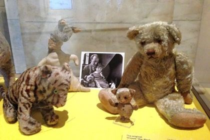 "'Winnie-the-Pooh' exhibit The original stuffed animals from A.A. Milne's ""Winnie-the-Pooh,"" with a photo of Milne and his son, Christopher Robin, at the exhibit."