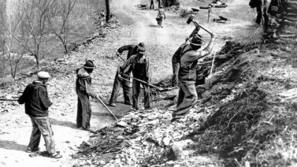 Work crew A Works Progress Administration crew builds a new farm-to-market road along Knob Creek in Tennessee in March 1936.