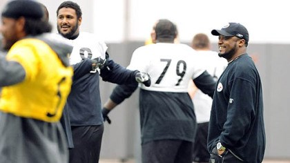 Working on a better game Mike Tomlin watches his team practice yesterday with offensive lineman Max Starks, who took over at left tackle in the sixth game of the season for Marvel Smith.