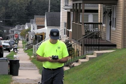 Working with water Meter reader John Vincent carries a handheld device to obtain readings of water meters on Arch Avenue in Greensburg. He is an employee of the Municipal Authority of Westmoreland County.