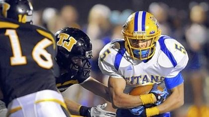 WPIAL West Mifflin running back Jimmy Wheeler carries the ball against Thomas Jefferson earlier this season.