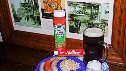 Wurst Wurst plate includes (left to right): Nurnberger bratwurst, knackwurst, bratwurst, sauerkraut and rottkraut. In background is curry ketchup, extra spicy mustard and Iron City Amber beer. Photos in frame are of Carl Meyer's Hof in Buffalo, N.Y.