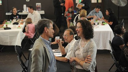 Young Preservationists Association Robert Ruck, left, talks with Catherine Stephens, both of Squirrel Hill, at the tenth anniversary celebration of the Young Preservationists Association of Pittsburgh on Saturday.