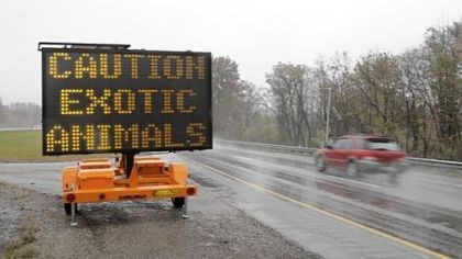 Zanesville Motorists driving I-70 near Zanesville, Ohio, Wednesday encountered this warning of exotic animals on the loose.