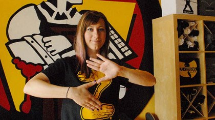 "Zoltan t-shirt Z sign Andrea Bible, who works at South Side T-shirt store CommonWealth Press, makes the Zoltan ""Z"" sign with her fingers while wearing the company's Zoltan shirt that is quickly becoming popular across the city."