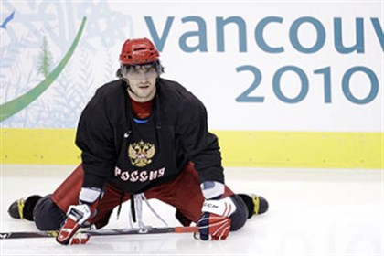 Alex Ovechkin Alexander Ovechkin, first one on the ice, stretches during a Russian Olympic team practice in Vancouver 2010.