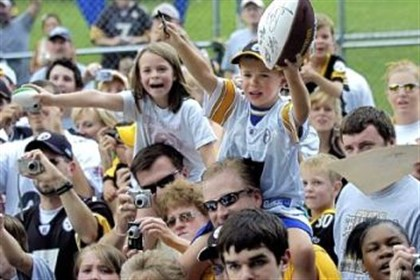 Black and gold Fans shout for autographs as the Steelers enter the field at training camp at Saint Vincent College in Latrobe last year.