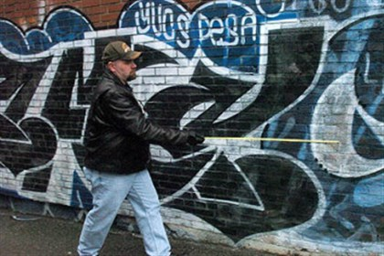 Police investigate graffiti Grafitti task force Detective Daniel Sullivan takes measurements on graffiti by Daniel Montano in 2007 in an alley on Melwood Avenue in Oakland. The task force, disbanded about a year ago, is being revived.