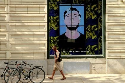 Warhol window A pedestrian walks by the window displays featuring video panels at The Andy Warhol Museum.