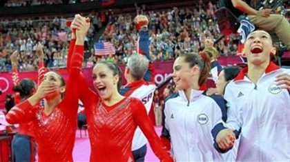 Gym win Alexandra Raisman, Jordyn Wieber, Mc Kayla Maroney and Kyla Ross of the United States celebrate during the final rotation in the Artistic Gymnastics Women's Team final on Day 4 of the London 2012 Olympic Games.