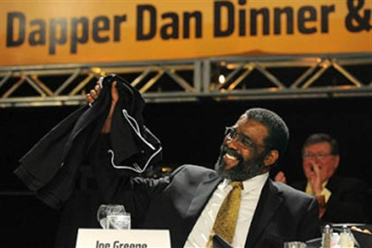 'Mean' Joe Greene at awards Former Steelers player Joe Greene holds up a shirt thrown to him by speaker Vince Sands, chaiman of BNY Mellon, a joking reference to the famous Super Bowl commercial starring Greene.