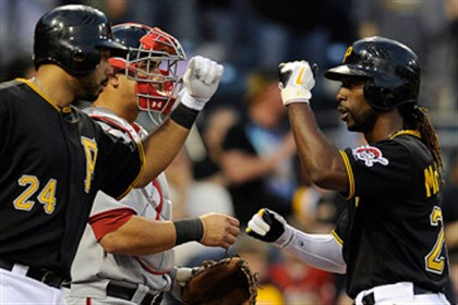 cutch_and_pedro.jpg The Pirates' Pedro Alvarez congratulates Andrew McCutchen after hitting his first home run of the 2013 season against Washington.