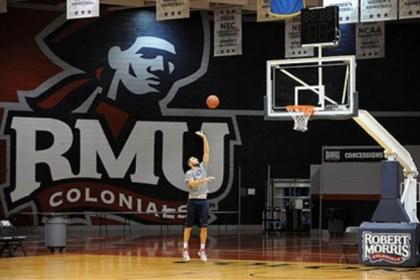 RUMgame_1 RMU basketball player Shane Sweigart takes advantage of the empty gym to get some shots in before the team's practice Monday. The basketball program is one of the sports program that is not affected by cuts.
