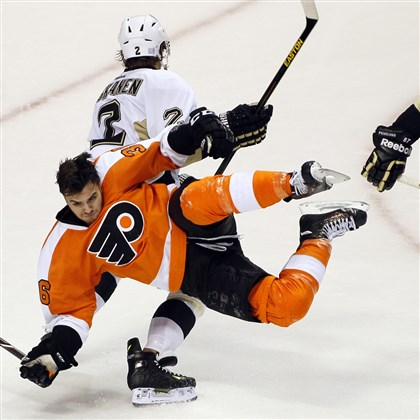 pens1018e-1 The Flyers' Zac Rinaldo is sent flying after a check by the Penguins' Matt Niskanen in the third period of a game last month in Philadelphia. The Penguins won, 4-1.