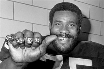 "Steeler ""Mean Joe Greene"" Steeler ""Mean Joe Greene"" sports his four Super Bowl rings on his fingers at Steelers training camp in Latrobe in 1980."