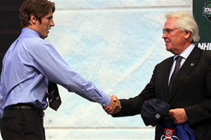 J.T. Miller and Glen Sather Forward J.T. Miller of Coraopolis shakes hands with Rangers general manager Glen Sather after being selected with the 15th overall pick of the NHL's 2011 entry draft at Xcel Energy Center in St Paul, Minn.